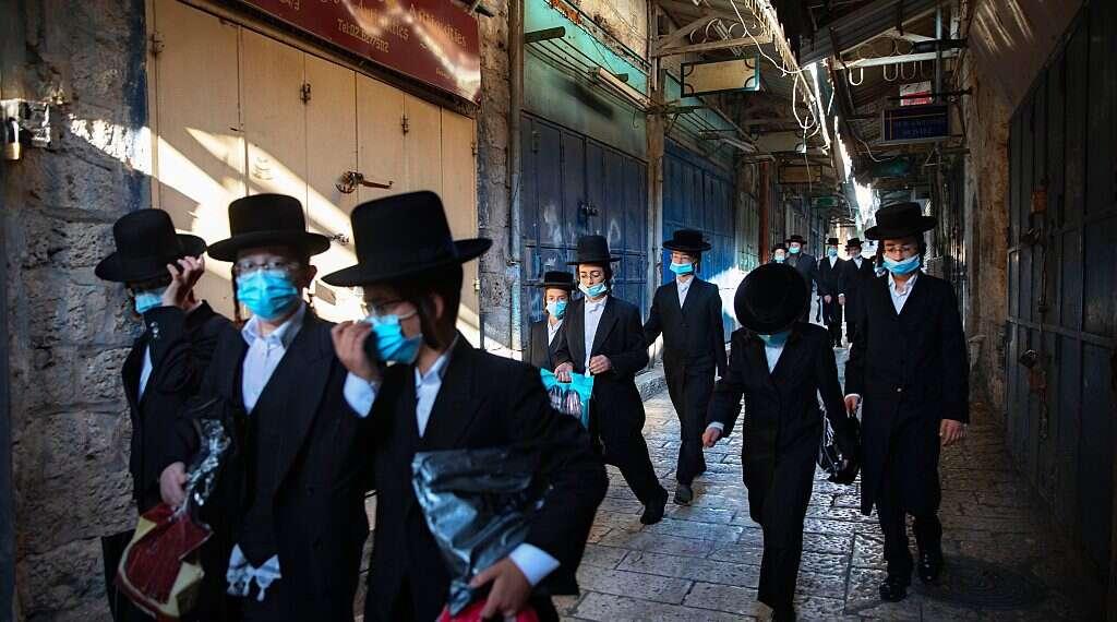 Anti-Semites exploit COVID-19 to blur line between Jews, Zionism -  www.israelhayom.com